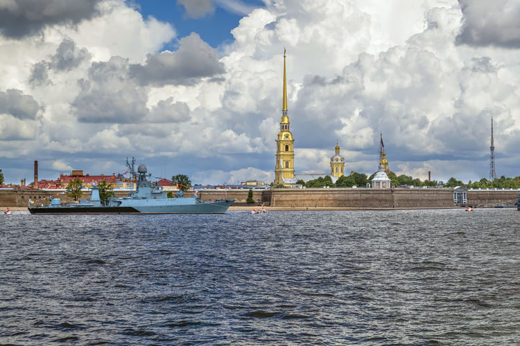 View of commercial dock against cloudy sky