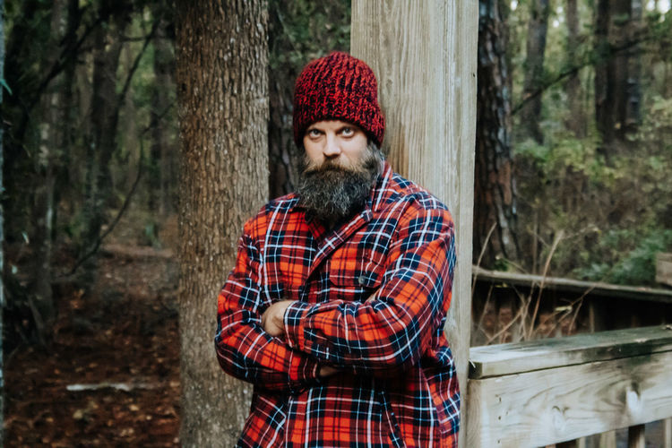 Portrait of man with beard in plaid.