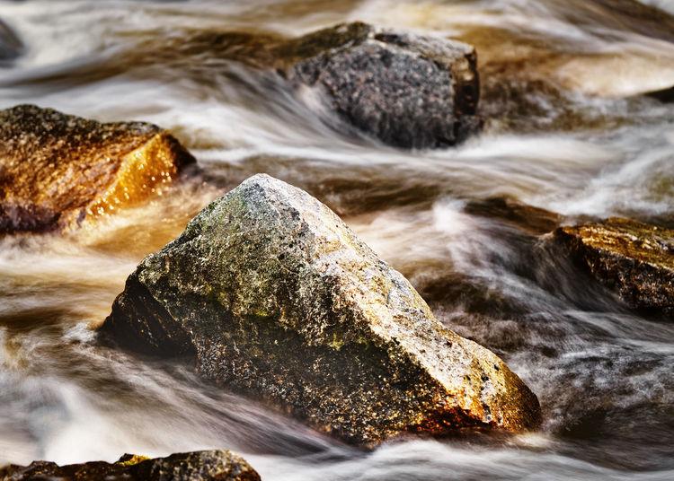 Close-up of rocks at beach