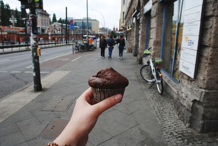Happines Is chocolate cupcake Cupcake Chocolate Street Ontheroad Streetphotography Citylife Berlin Colors People Close-up Built Structure Buildings Hand Hanging Out Happiness Human Hand City Architecture Dessert Sweet Food Cupcake Holder Dark Chocolate Chocolate Cake Moments Of Happiness