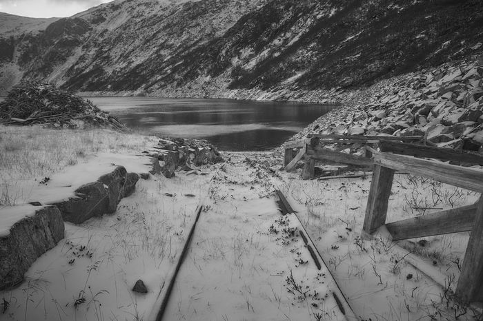 B/w Black And White Fjord Landscape Mountain Mountain Range No People Outdoors Railroad Track Snow Tranquility Water