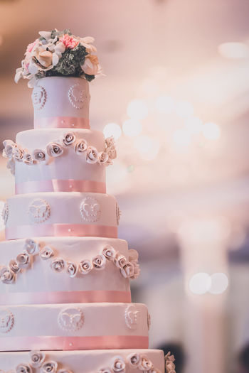 Wedding cake and wedding candlestick with flower decoration the joy symbol of the bride.