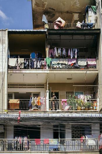 People in balcony against sky in city