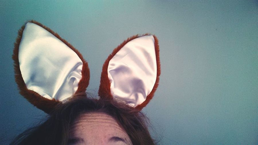 Cropped Image Of Woman Wearing Bunny Ears