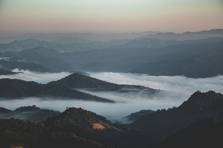 Mountain Scenics - Nature Beauty In Nature Tranquil Scene Tranquility Mountain Range Fog Sky No People Environment Non-urban Scene Nature Idyllic Landscape Cloud - Sky Remote Sunset Majestic Outdoors Hazy  Mountain Peak