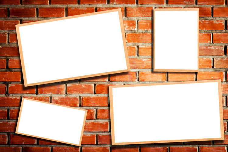 Blank Placards Hanging On Brick Wall