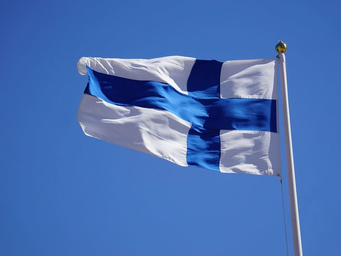flag of Finland Finland Finland Flag Finish Flag Flags Blue Cross Blue Cross Flag Blue Flag Sky Blue Background Wind National Icon National Flag Waving Symbolism Patriotism Flag Pole