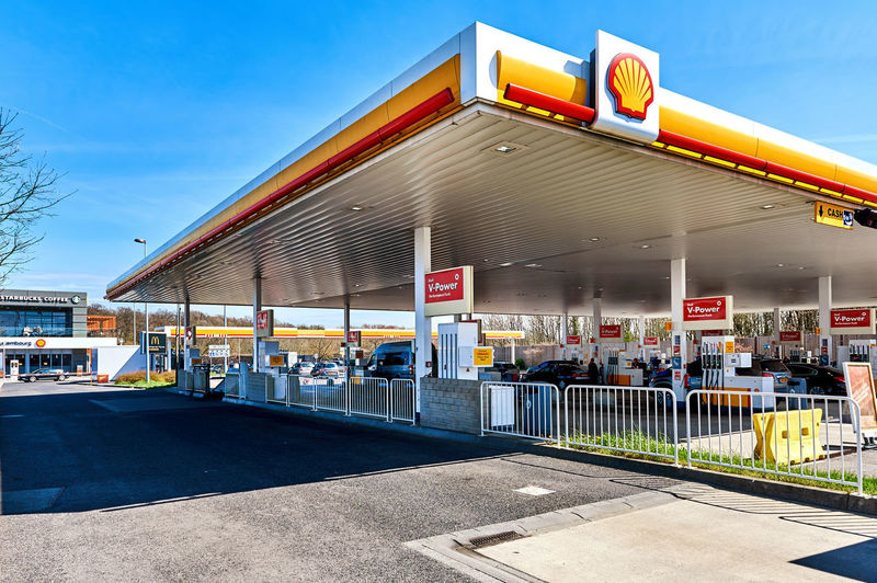 Luxembourg - April 10, 2016: Shell gas station on the border of Luxembourg and France. The cheapest fuel in Central Europe. Shell is an Anglo-Dutch multinational oil and gas company headquartered in the Netherlands and incorporated in the United Kingdom Badge Blue Sky Border Brand City Company Logo Day Diesel Distribution Dutch Editorial  Energy Europe Famous France Fuel Fuel Tank Gasoline Label Luxembourg Outdoors Petrol Station Petroleum Sign Sunny Day