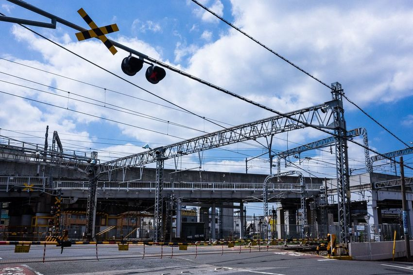 Railway Cloud - Sky Sky Architecture Built Structure Building Exterior Nature Cable City Electricity  No People Day Low Angle View Outdoors Street Transportation Industry Building Power Supply Electricity Pylon Power Line