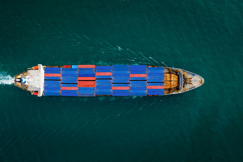 Aerial top view container cargo ship in import export business services commercial trade