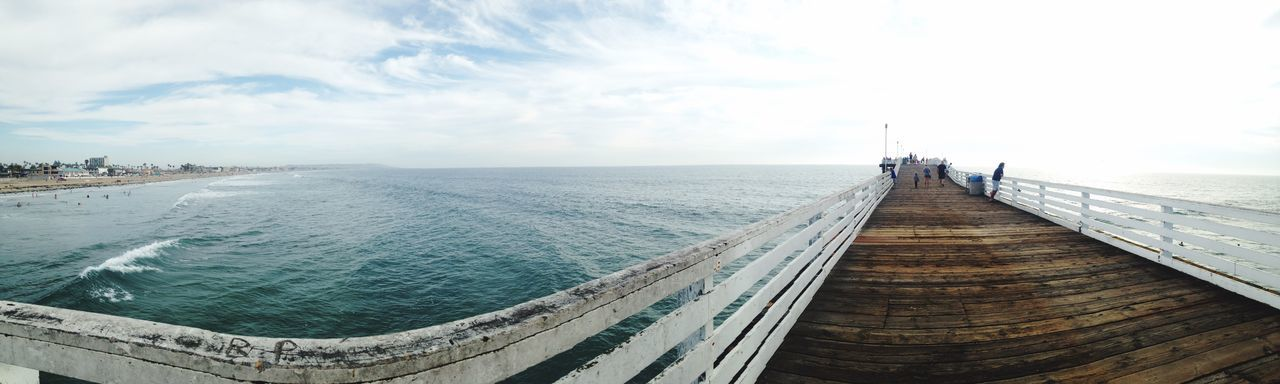 Panoramic view of pier in sea against sky