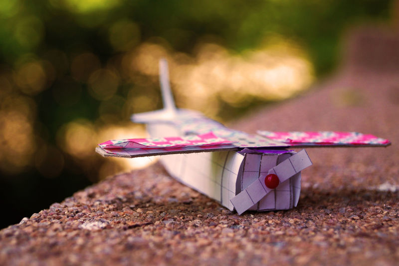 Close-up of paper airplane on steps