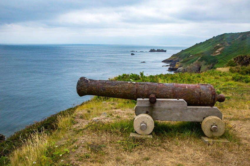 English Channel Eperquerie Isle Of Sark Beauty In Nature Cannon Canon Cloud - Sky Day Grass History Horizon Over Water Island Military Nature No People Outdoors Sark Scenics Sea Sky Tranquility Travel Destinations War Water Weapon
