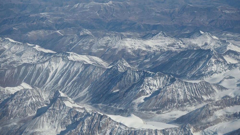 From An Airplane Window Mountains Landscape Aerial