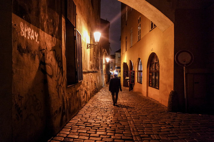 Architecture City City Life Full Length Illuminated Light And Shadow Lighting Equipment Night Nightphotography One Person People Prague Rear View The Way Forward Walking