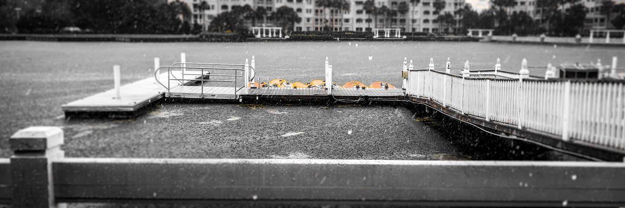 Tilt-shift image of boat moored in river