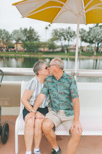 Couple sitting on swimming pool