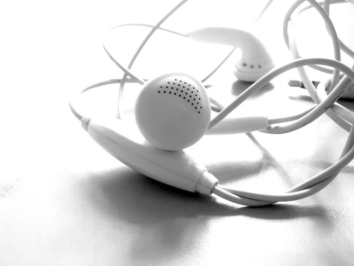 Tangled earphones Earphones Playing Music Song Tangled Wire Mobilephotography PhonePhotography White Background Close-up