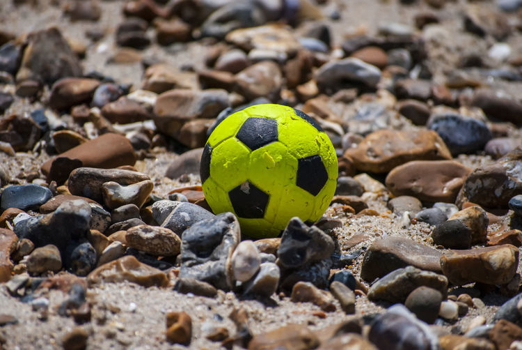 Close-Up Of Ball And Pebbles