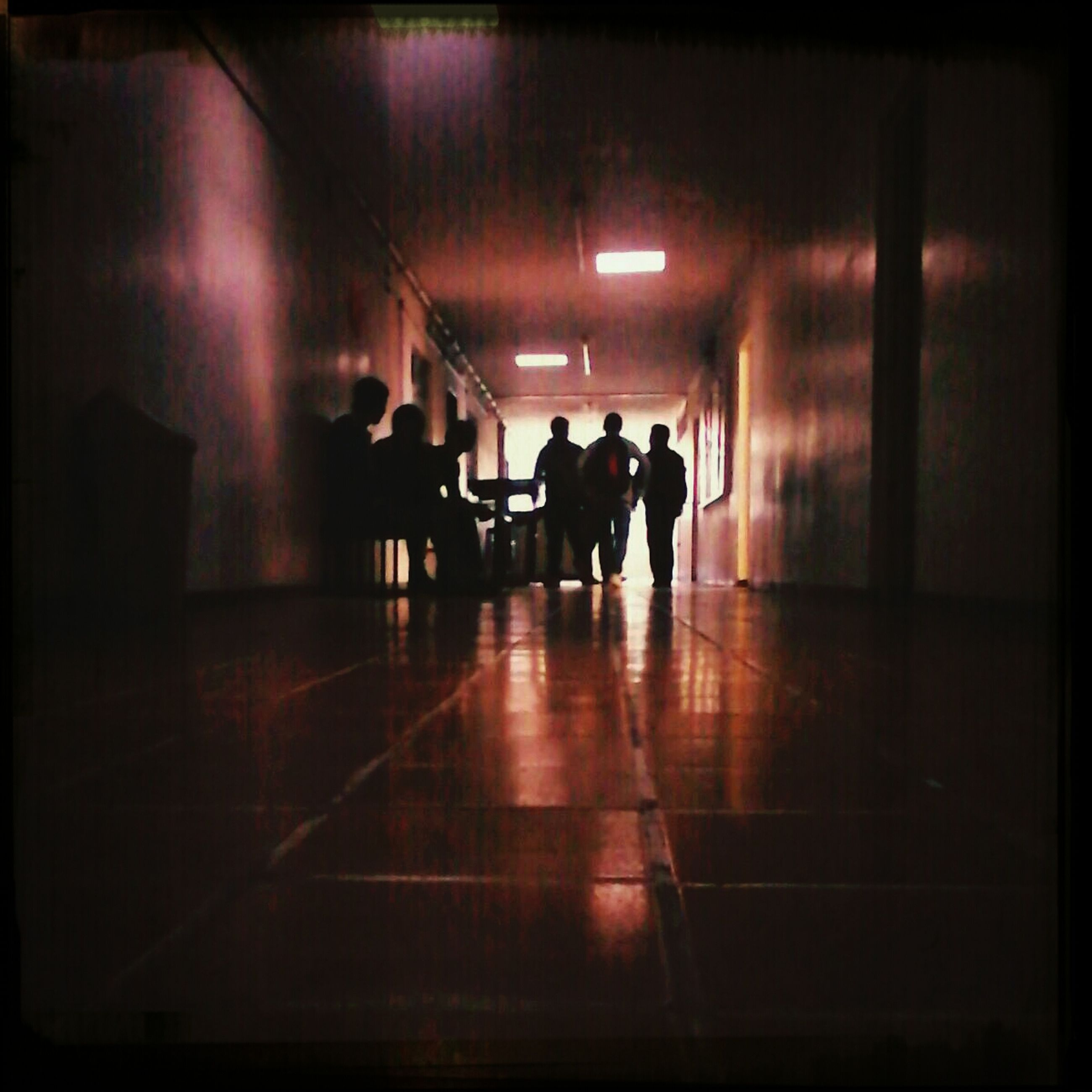 indoors, men, illuminated, walking, lifestyles, full length, silhouette, tunnel, person, rear view, leisure activity, subway, corridor, the way forward, lighting equipment, night, built structure