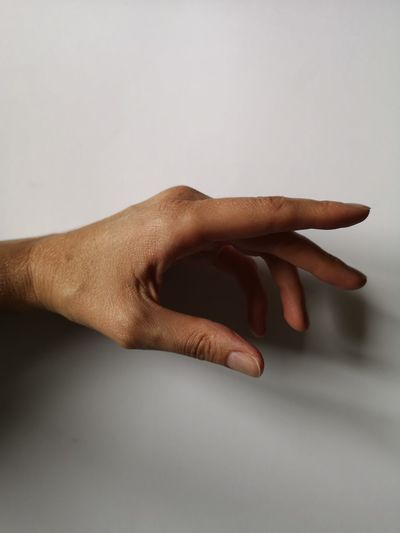 Close-up of hand against white background