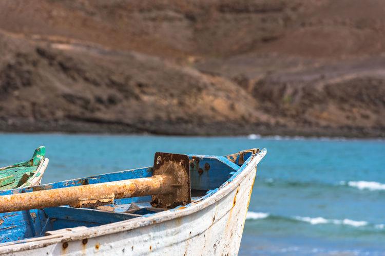 Boat moored on sea shore