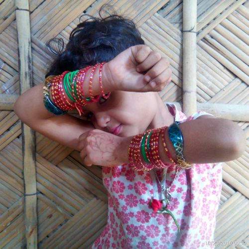 Close-up of girl wearing bangles