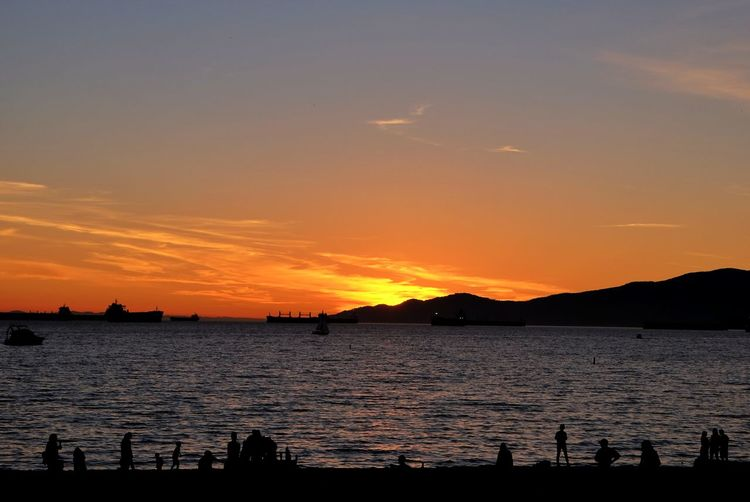 Summer Sunset at English Bay Sunset Water Silhouette Beauty In Nature Outdoors No People Refraction Nature Sky Mountains And Sky Red City Landscape Tranquility High Angle View English Bay Vancouver BC Straightoutofcamera Nature CityWalk Eyemphotography Beauty In Nature Silhouette Fujixseries Taking Photos Cloud - Sky
