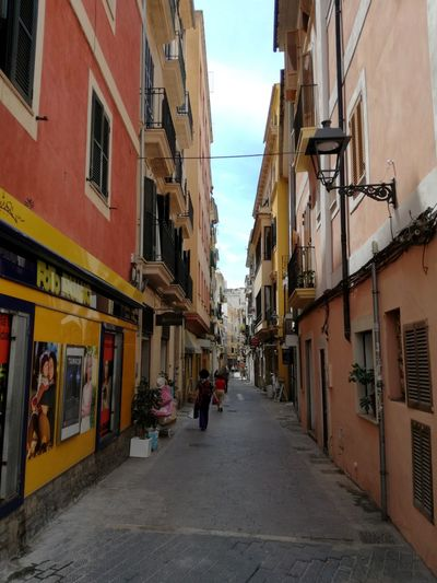 Streetphotography Palma De Mallorca Streets Of Palma City Full Length Sky Architecture Building Exterior Built Structure Narrow Old Town Pathway The Way Forward vanishing point Diminishing Perspective Residential Structure Lane