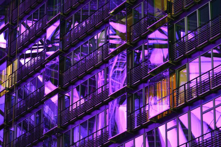Purple Glow Built Structure No People Purple Illuminated Façade Windows Glass Reflection Exterior Modern City Urban Berlin Germany
