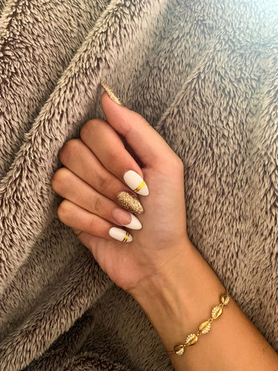 Close-up of woman with nail art