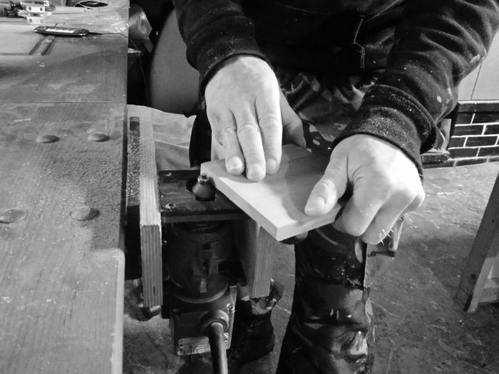Close-Up Mid Section Of Carpenter At Work