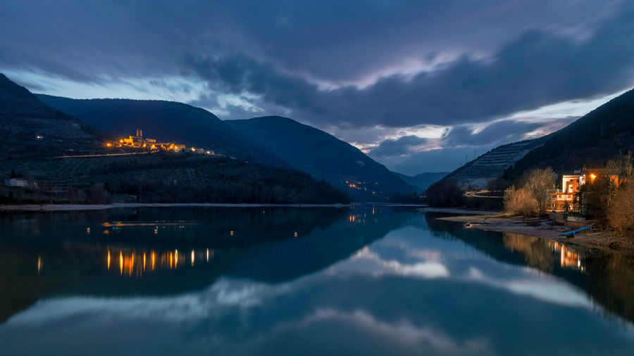Blue time at Caccamo lake Marche Marche Region Caccamo Caccamo Lake Mountain Reflection Water Cloud - Sky Sky Scenics - Nature Beauty In Nature Tranquility Tranquil Scene Lake Mountain Range Waterfront Nature No People Illuminated Idyllic Dusk Non-urban Scene