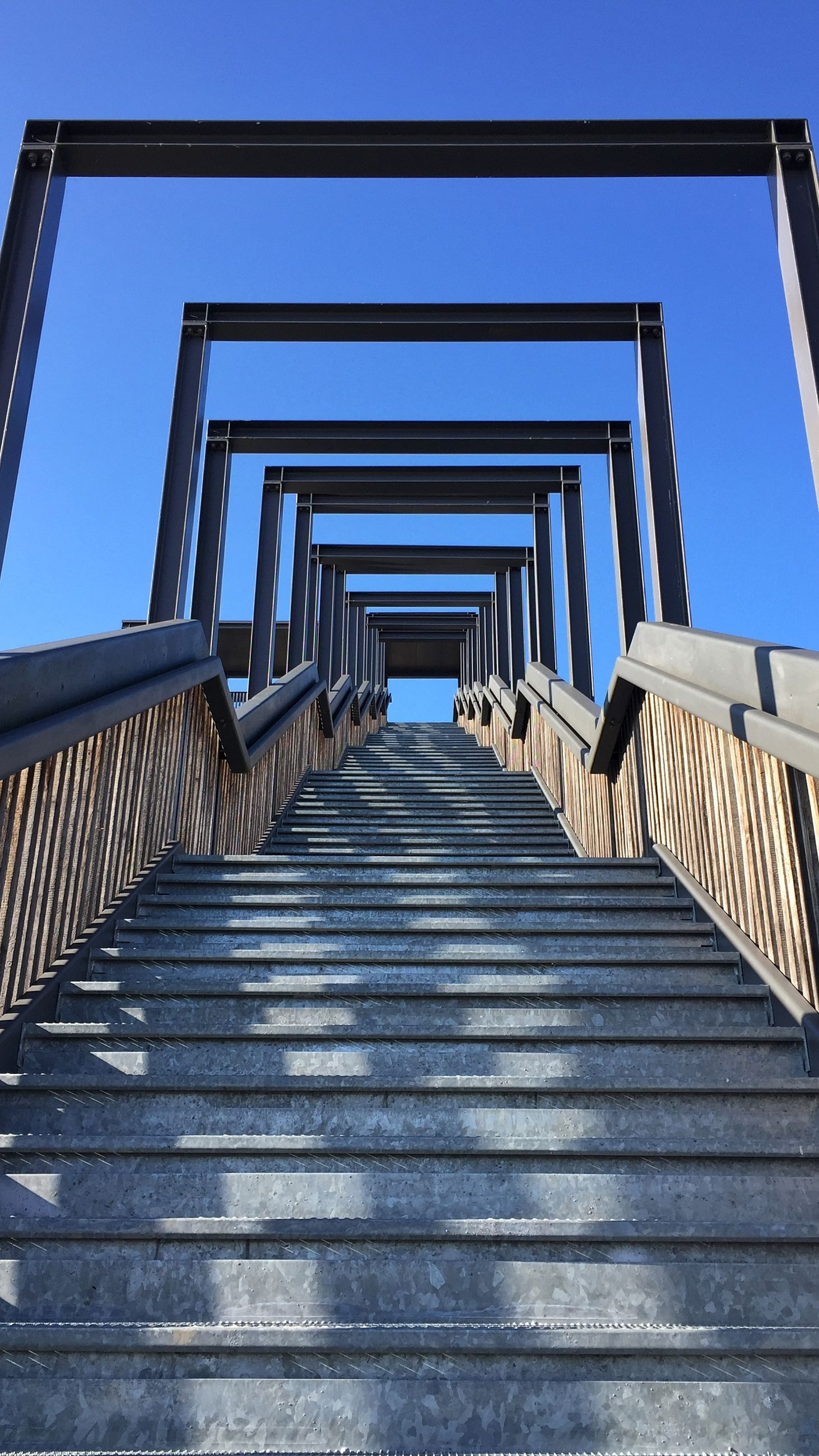 architecture, built structure, building exterior, low angle view, steps, steps and staircases, staircase, blue, railing, house, clear sky, residential structure, roof, sky, building, stairs, sunlight, the way forward, residential building, day
