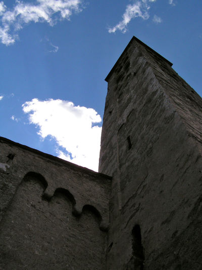 Chiesa di San Giorgio a Grosio (Sondrio) Church Perspective Architecture Building Building Exterior Built Structure Cloud - Sky Clouds Low Angle View Place Of Worship Sky Spirituality Stone Wall Tower Bell
