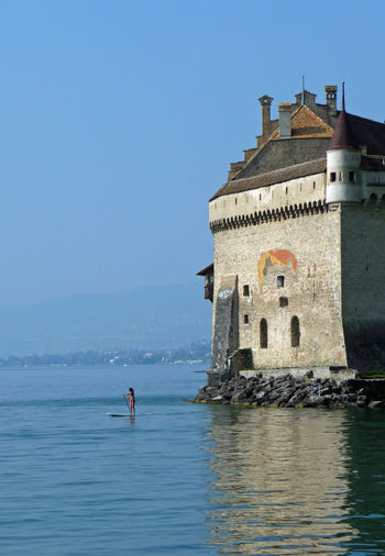 Castle chateau chillon at sea against clear sky