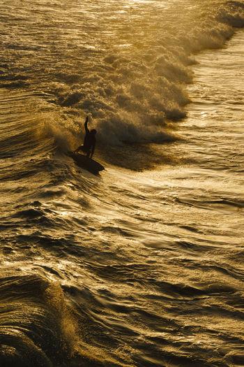 Man surfing in sea
