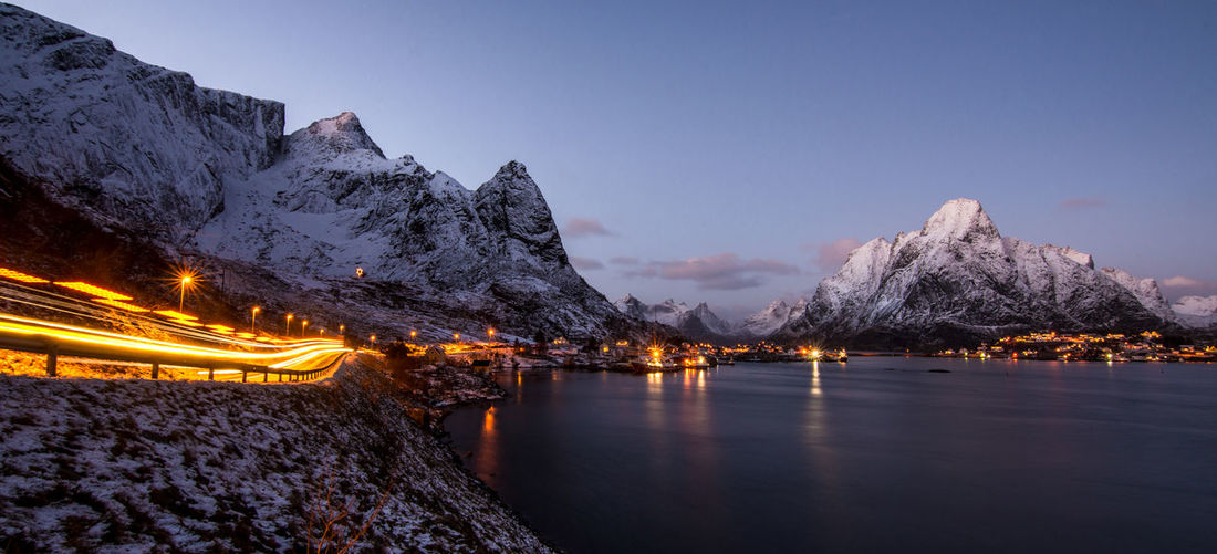 Driving into Sunset on Lofoten Islands Norway Beauty In Nature Illuminated Light Trail Light Trails Lofoten Lofoten Islands Mountain Mountain Range Nature Night No People Norway Norway🇳🇴 Outdoors Panorama Reine Scenics Sky Snow Tranquil Scene Tranquility Transportation Tree Water Winter EyeEmNewHere Your Ticket To Europe Been There. Shades Of Winter An Eye For Travel Mobility In Mega Cities Adventures In The City The Traveler - 2018 EyeEm Awards Holiday Moments Capture Tomorrow