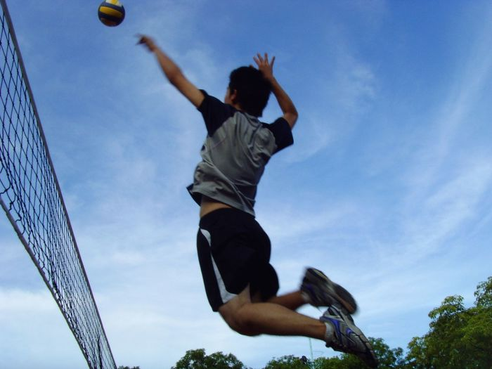 Full Length Of Man Playing Volleyball Against Sky