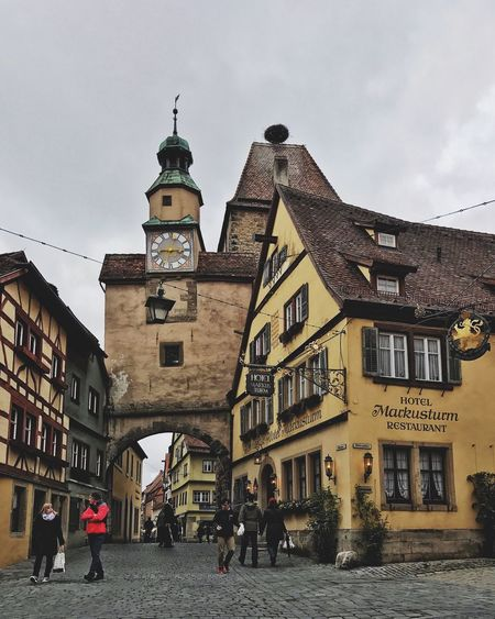 Old Town Architecture Building Exterior Built Structure City Day Men Old Old Buildings Outdoors People Rothenburg Rothenburg Ob Der Tauber Sky