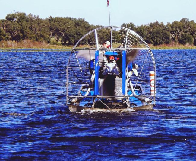 Taking Photos Airboat on Lake Nature Photography Hanging Out Water Reflections