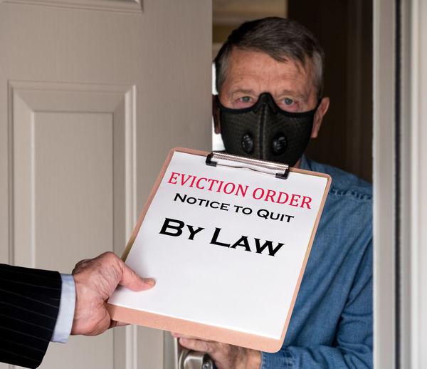 Portrait of man holding text on door