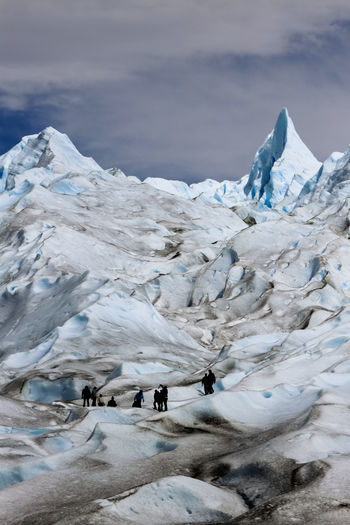 Ice climbing on the Perito Moreno Glacier. The glacier consists of over 250 km2 (97 sq mi) of ice spanning 30 km (19 mi) in length and a width of 5km at its terminus. One of 48 glaciers that form part of the Southern Patagonian Ice Field, the high altitude ice field has a total area of 12,363 km2 (4,773 sq mi) of ice. Los Glaciares National Park, Santa Cruz , Argentinean Patagonia, Argentina. Love Life, Love Photography America Argentina Beauty In Nature Blue Cliff Climbing Cold Temperature People Glacier Ice Landscape Moreno Mountain Nature Outdoors Patagonia Perito Moreno. Patagonia. Argentina. Sky Snow Southern IceField Glaciers Glacier Surreal Fractured Perspectives On Nature