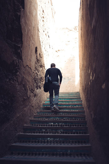 follow the light Morocco X100S Day Fujifilm_xseries Lifestyles Love The Game Low Angle View Men Moving Up One Person Outdoors Real People Rear View Staircase Steps And Staircases The Way Forward Travel Walking A New Beginning A New Perspective On Life