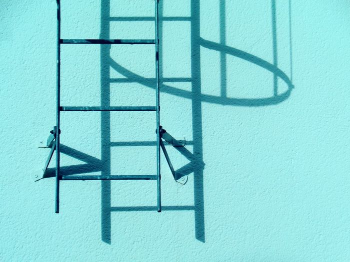 Ladder on turquoise wall
