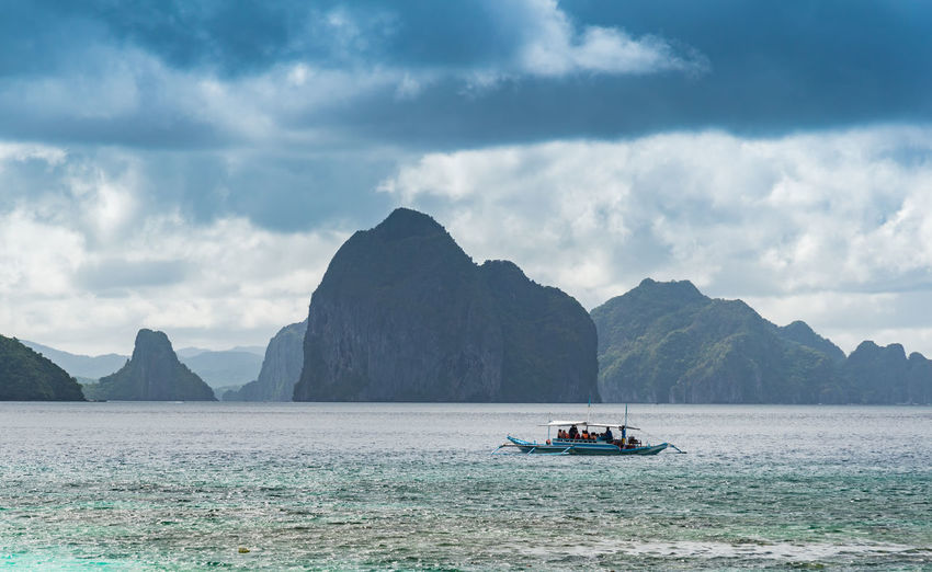 Astrology Sign Beauty In Nature Cloud - Sky Day Landscape Mountain Nautical Vessel No People Outdoors Rock - Object Scenics Sea Tourism Tranquil Scene Travel Destinations Vacations Water