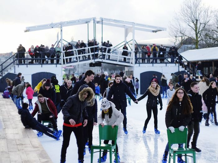 Ice skating in Amsterdam Large Group Of People Winter Cold Temperature Arts Culture And Entertainment Leisure Activity Enjoyment Outdoors Lifestyles Real People Snow Day Ice-skating Ice Rink Crowd
