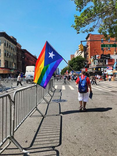 Puerto Rican Pride Thestreetphotographer2017eyeemawards Newyork Iphone7 ShotOnIphone Mobilephotography Lgbtq City Building Exterior Real People Architecture Built Structure Flag Love Is Love People Street The Troublemakers #urbanana: The Urban Playground This Is Strength