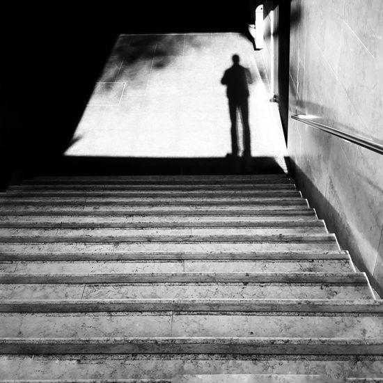 Shadow of person walking on corridor