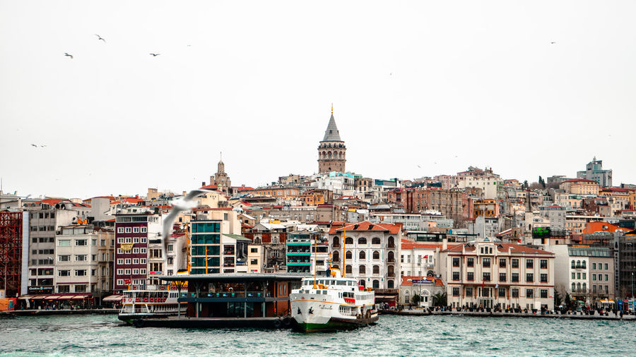 View of buildings and ferry in galata